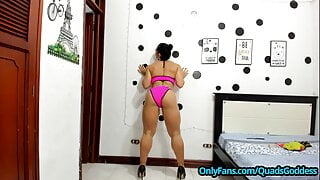Extreme Muscular Woman in Pink Dress and Black High Heels