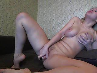 Sticking stuff in a cunt Horny blonde slut stuffs her cunt arse with dildos