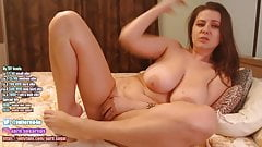 Busty brunette fingering her pussy with a dildo