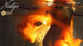 Blonde super tight teen Nastya underwater