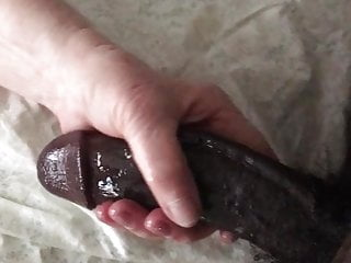 Stroking athick black cock White granny loves stroking my big black cock