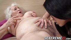 Wicked lesbian pleases stunning girl by giving her Rimjob