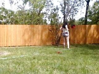 Vintage buckner 860 sprinkler Chubby gal plays with sprinkler