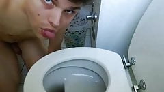 Christian licking a toilet seat
