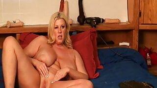 Blonde Milf have fun on Bedwith Toys
