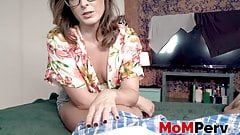 MILF with glasses rides her big cocked stepson on the bed