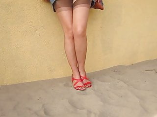 Naked in sand - Stocking heels playing in sand