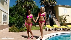 Hot tanned lesbians Lena and Kari have hot sex outdoors near