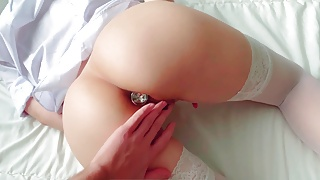 Fucked a slender blonde with an anal plug in the ass