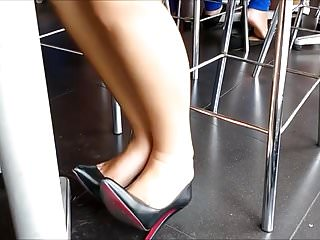 Pierced under spiked heels fetish Candid feet in her new louboutins under table candid gf