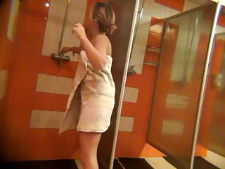 Room shower voyeur - Voyeur tanned blonde in the womens shower room.