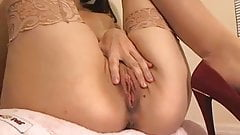 Busty slut fingers her twat on webcam