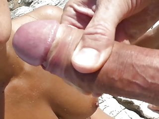 In public with a facial Cute girl takes a facial cumshot in public on the beach