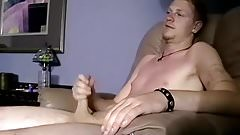 Good looking dude strips and starts playing with his rod