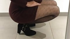 woman in mini skirt showing her pantyhose