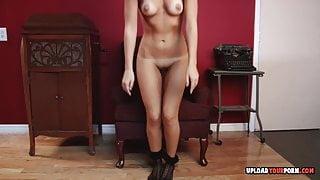 Hot blonde strips off her black pantyhose