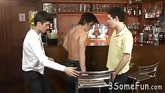 Three young hunks swallow meat at the bar counter