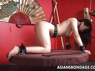 Free bound asian porn - Bound asian skank on a revolving platform gets stimulated