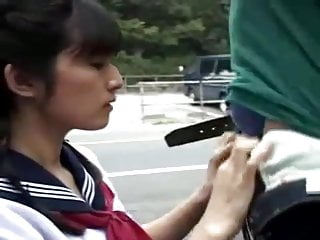Two asians blowjob - Asian girl gives head to two guys in public