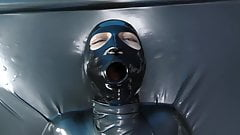 Girl in Latex Catsuit Enters Vacbed