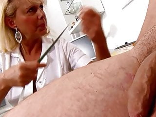 Average penis measurement - Mature blonde nurse measures patients penis soft and erect