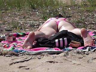 Enormous boobs brunette in pink bikini Pink bikini close up