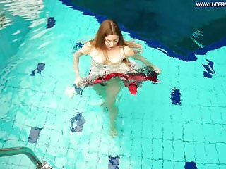 Bikini girl roxy swim wear Hot polish redhead swimming in the pool