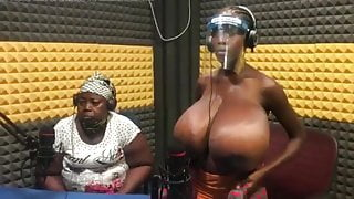 African stepmum showing her daughter's enormous tits