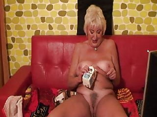 Videos mature granny - Mature granny pouring milk down her pussy.