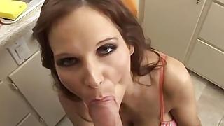 Busty brunette MILF sucking her neighbors big cock