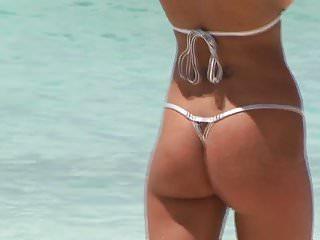 Kristin cavallaris bikini body - Busty beach babe in micro bikini showing her amazing body