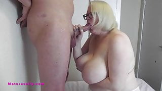 Look at me, busty Sally plays with his cock