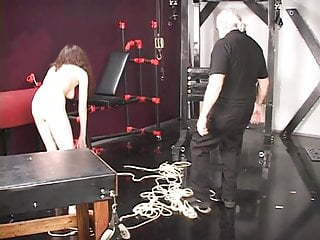 Teen slavegirl punished in dungeon Master len canes and spanks a young brunette victim slave girl in dungeon