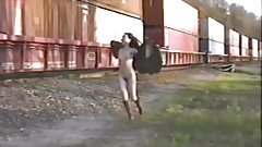 Asian girl in trench coat flashes train