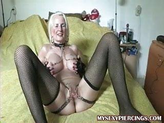 Bikini chain Pierced granny with chains to her pierced pussy lips