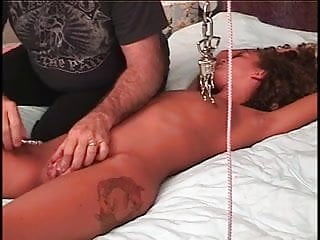 Tortured a gay man Young brunettes shaved pussy is tortured on bed by older slave master man