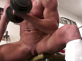Buff gay sex Sexy buff blonde works out her big clit in the gym