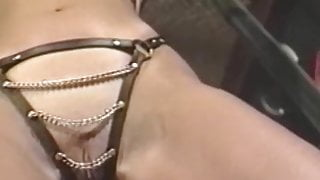 Busty blonde sub tied up for spanking in BDSM dungeon