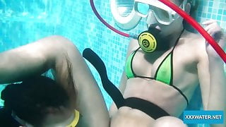 Two hot lesbians playing with dildos in the pool
