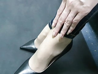 Asian long nail pics Asian beauty scraching her feet high heels with long nails