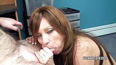 Mature tart Brandi Minx is on her knees blowing a geek