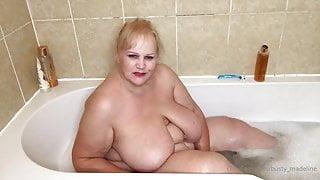 Mature big tits taking a bath