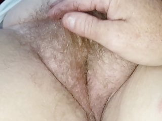 My wifes hairy bush Closeup of my fingers going through her hairy bush