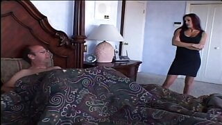 Slutty MILF surprises dude lying in bed with a blowjob