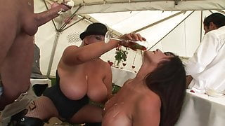 Wet and wild ladies have sexy romp under a big tent