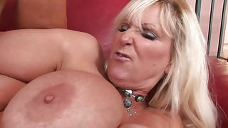 Blonde MILF with big tits and a boy with a big dick
