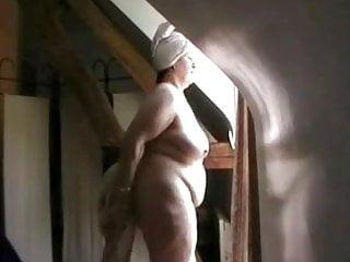 Nude women in window - Nude in front of the window