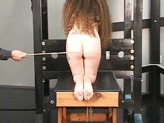 Penis lengthening device Long haired hussy is bent over sex device and gets her ass caned