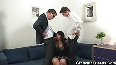 Two dudes are banging huge titted mature bitch