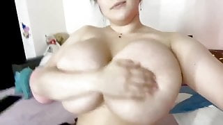 Huge boobs dumb girl playing with her udders